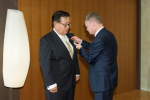 Ambassador of France to Japan, Mr. Laurent Pic, awarding medal to Professor Murai